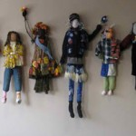 Wall installation of figures created with Amy Rich by students at Mercy Montessori students grades 4-8